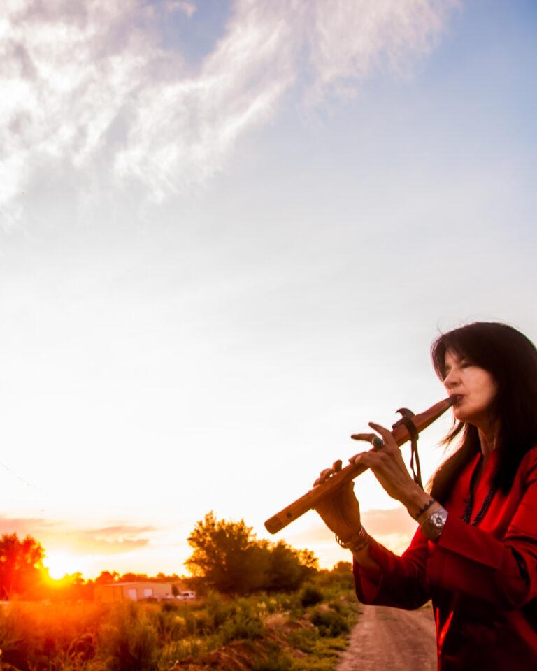 Joy Playing flute w horse -- Photo by Karen Kuehn